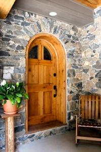 Custom arched door by Shawn Hollenshead Cabinetry.