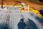 radiant heating, radiant flooring, PEX tubing, insulated foundation, vapor barrier, air barrier, moisture barrier, rigid insulation